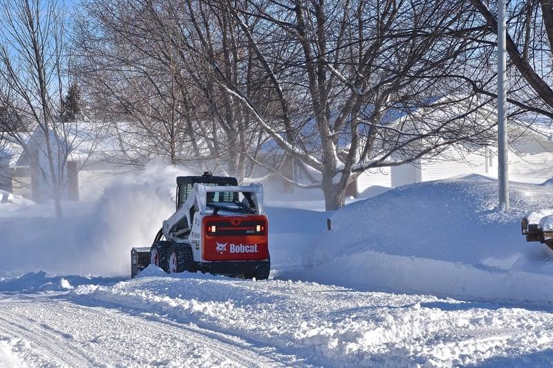 skid steer blowing snow